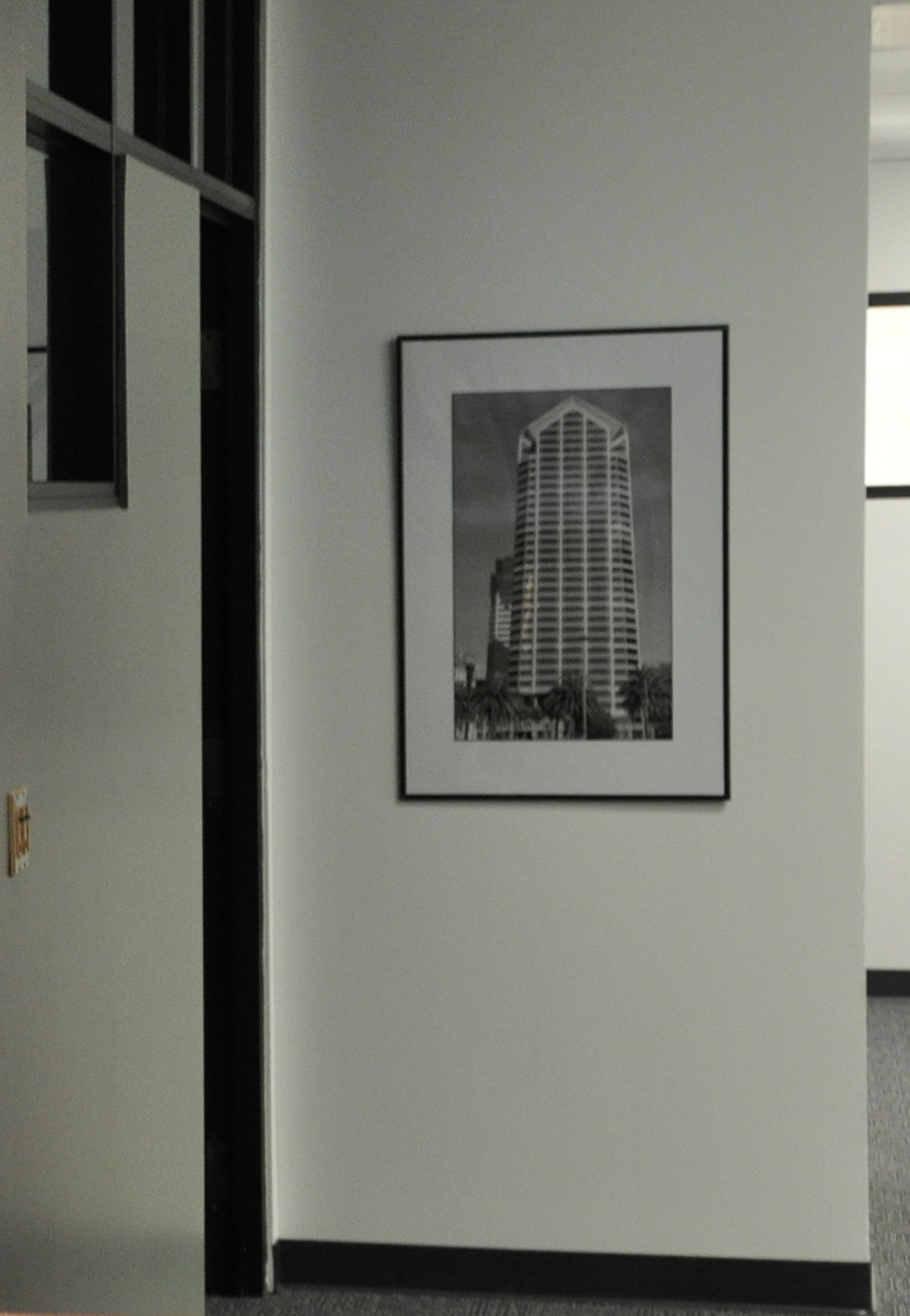 framed tower piece hung on wall