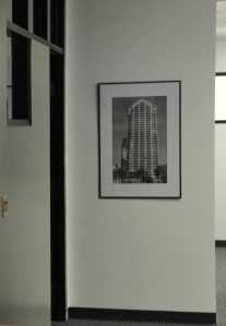 Framed Tower piece hung on wall.