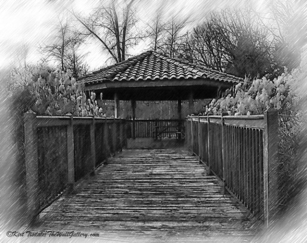 Riverside Pavilion is a black and white sketched art print of a paviliion just off of a wooden walkway. The setting is along a river in Rockford, Michigan. The area has wooden walkways that follow the river banks on either side of town.  The usage of black and white sketches as a wall art print lends itself to many different types of interior design, from contemporary to traditional. I think what dictates the look is the subject matter of the photograph and the manner in which it is framed and matted.